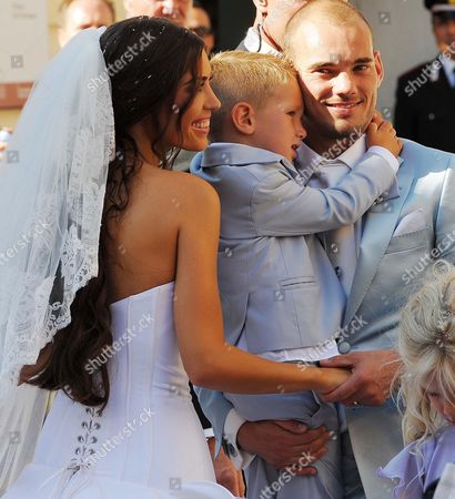 Dutch Midfielder Wesley Sneijder of Inter Milan His Son Jessey and His Bride Dutch Actress and Model Yolanthe Cabau Van Kasbergen at the End of Their Wedding Ceremony in the Santi Giusto E Clemente's Church in Castelnuovo Berardenga in the Province of Siena Italy on 17 July 2010 Italy Castelnuovo Berardenga