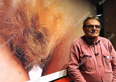 Italian Photographer Oliviero Toscani Poses in Front Af a Huge Copy of a Page of the 'Consorzio Vera Pelle Italiana Conciata Al Vegetale' Association's 2011 Calendar Depicting His Photograph of a Woman's Genitals at Florence's Leopolda Station During the 79th Edition of Pitti Uomo Men's Fashion Show Florence Italy Florence 13 January 2011 the Fashion Trade Show Runs From 11 January 2011 Until 14 January 2011 Italy Florence