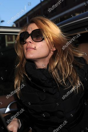 Stock Image of Italian Escort Nadia Macri Leaves the Court at Piazza Umanitaria in Milan Italy 24 January 2011 After the Hearing Launched by the Milan States Attorney Office Looking Into Allegations That Italian Prime Minister Silvio Berlusconi Engaged a Minor Named Karima El Mahroug (aka Ruby) As a Prostitute Macri Claimed She Saw Ruby Receiving Money From Berlusconi who is Under Investigation Macri's Boyfriend Francis Cagliari Said That She Will Bring New Proofs Italy Milan
