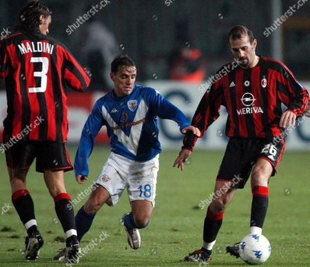 Milan's Giuseppe Pancaro is Challanged by Brescia's Antonio Filippini (c During Their Seria a Soccer Match in Brescia Sunday 18 January 2004 Milan Won 1-0 Italy Brescia