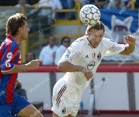 Milan's Ukrainian Player Andriy Schevchenko (r) Fights For the Ball with an Unidentified Bologna Player During the Serie a Soccer Match Bologna Vs Milan Sunday 19 September 2004 in Bologna Italy Italy Bologna