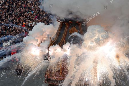 The 'Explosion of the Cart ' a Folk Tradition Takes Place in Florence Italy 04 Aprile 2010 on Easter Sunday a Cart Packed Full of Fireworks and Other Pyrotechnics is Lit and Provides a Historic Spectacle in the Civic Life of the City the 30 Foot Tall Antique Cart Moves From the Porta Al Prato to the Piazza Del Duomo Hauled by a Team of White Oxen Festooned with Garlands of the First Flowers and Herbs of Spring the Cart is Escorted by 150 Soldiers Musicians and People in 15th Century Costumes Meanwhile a Fire is Struck Using the Historic Flints From Jerusalem at the Chiesa Degli Santi Apostoli It is Then Carried in Procession to the Cathedral Square by Members of the Pazzi Family Clerics and City Officials the Cart is Loaded with Fireworks While a Wire Stretching to the High Altar Inside the Cathedral is Fitted with a Mechanical Dove the 'Columbina' Shortly After That the Cardinal of Florence Lights a Fuse in the Columbina with the Easter Fire Italy Florence