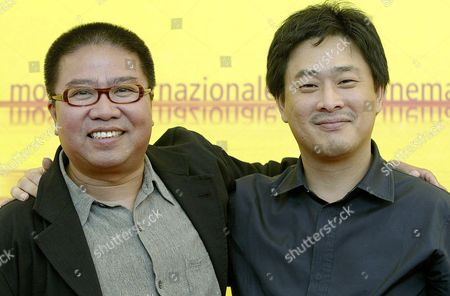 Chinese Movie Directors Fruit Chan and Park Chan-wook Embrace Each Other at the End of a Press Conference Held on Monday 06 September 2004 to Present Their Film 'Three Extremes' Which Will Be Screened Later Today out of Competition at the 61st International Exhibition of Cinema Art Better Known As Venice Film Festival Italy Venice