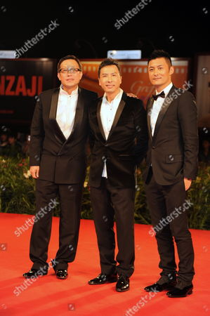 L-r: Chinese Director Andrew Lau and the Actors Donnie Yen and Shawn Yue on the Red Carpet Attend the Premiere of the Movie 'Legend of the Fist: the Return of Chen Zhen' at the 67th Annual Film Festival in Venice Italy 01 September 2010 Italy Venezia