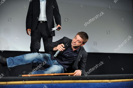 Italian Director Aureliano Amadei Falls Down Onstage After Receiving the Controcampo Italiano Award For His Movie '20 Sigarette' During a Ceremony at the 67th Annual Venice Film Festival in Venice Italy 09 September 2010 Cast Member Vinicio Marchioni was Also Awarded a Special Mention by the Controcampo Italiano Jury the Festival Runs From 01 to 11 September Italy Venice