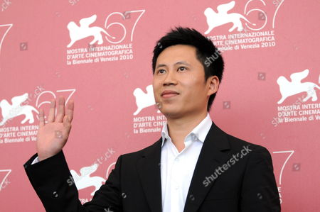 Chinese Actor Lu Ye Poses During the Photocall For the Movie 'Le Fosse' (the Ditch) at the 67th Annual Venice Film Festival in Venice Italy 06 September 2010 'Le Fosse' by Chinese Director Wang Bing is the Surprise Movie Presented in the International Competition 'Venezia 67' at the Festival Running From 01 to 11 September 2010 Italy Venice