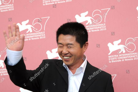 Chinese Director Wang Bing Poses During the Photocall For the Movie 'Le Fosse' (the Ditch) at the 67th Annual Venice Film Festival in Venice Italy 06 September 2010 'Le Fosse' is the Surprise Movie Presented in the International Competition 'Venezia 67' at the Festival Running From 01 to 11 September 2010 Italy Venice
