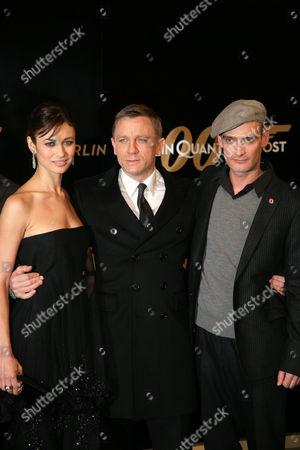 Olga Kurylenko, Daniel Craig and Anatole Taubman