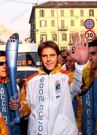 Emmanuele Filiberto of Savoy the Son of Savoy's Prince Vittorio Emanuele Waves As He Carries the Olympic Torch Thursday 09 February 2006 in Turin the Winter Olympic Games Will Be Opened Tomorrow Friday February 10 2006 Italy Turin