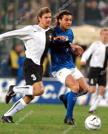 Italian Cristian Vieri (r) Fights For the Ball with Russian Sennikov During an International Soccer Friendly Match Against Russia in Cagliari Italy Wednesday 09 February 2005 Italy Caligari