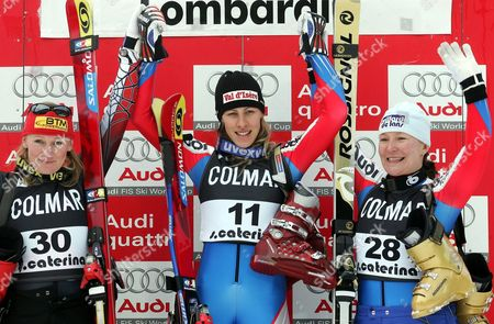 French Ingrid Jacquemond (c) Jubilates on Winner's Podium After Winning a World Cup Rescheduled Women's Downhill Race Between Second Placed Austrian Renate Goetschl (l) and Third Placed Compatriot Carole Montillet-carle on Friday 07 January 2004 Italy Santa Caterina