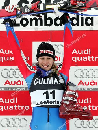 France's Ingrid Jacquemond Jubilates on Winner's Podium After Winning the the Rescheduled Women's World Cup Downhill Race on Friday 07 January 2004 Austria's Renate Goetschl was Placed Second and France's Carole Montillet-carles Third Italy Santa Caterina