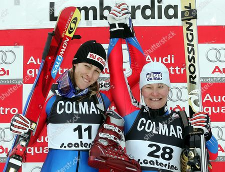 French Ingrid Jacquemond (l) Jubilates on Winner's Podium with Third Placed Compatriot Carole Montillet-carle After Winning a World Cup Rescheduled Women's Downhill Race on Friday 07 January 2004 Italy Santa Caterina