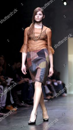 A Model Presents on the Catwalk in Milan Thursday 24 February 2005 a Proposal by Miou - Miou 'S Autumn Winter Women Pret a Porter 2006 Collection Italy Milano