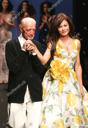 Italian Stylist Lorenzo Riva (l) Walks on the Catwalk with Italian Actress Eva Grimaldi at the End of the Show of His Collection For the High Fashion Week in Rome Italy Monday 30 January 2006 Italy Rome