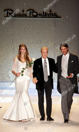 Actors Vanessa Hessler (l) and Fabio Fulco (r) Parade on the Catwalk Wearing Wedding Dresses with Italian Stylist Renato Balestra (c) at the End of His Show in Rome's Auditorium 'Park of the Music' to Conclude the Altaroma Altamoda Women High Fashion Week Late Tuesday 31 January 2006 Italy Rome