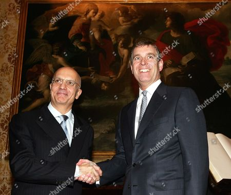 Britain's Prince Andrew Duke of York (r) Shakes Hands with Milan's Mayor Gabriele Albertini in Marino Palace Milan's City Hall on Tuesday 23 November 2004 During His Official Visit to Mark the Centenary of British Trade Chamber Italy Milan