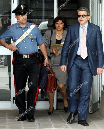 Gip (magistrate in Charge of Preliminary Investigfations) Alberto Iannuzzi (r) Leaves Potenza's Tribunal to Go to the Jailhouse and Interrogate Prince Vittorio Emanuele Di Savoia and Roberto Salmoiraghi Mayor of Campione D'italia an Italian Enclave on Lake Lugano Near the Swiss Border on Tuesday 20 June 2006 Prince Vittorio Emanuele Di Savoia 69-year-old Son of Italy's Last King was Arrested on Friday 16 June As Part of a Two-year Investigation Into Corruption and Prostitution Salmoiraghi is Under House Arrest Italy Potenza