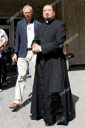 Don Luigi Abid Sid (r) the 'Spiritual Assistent' of Prince Vittorio Emanuele Di Savoia the 69-year-old Son of Italy's Last King and an Unidentified Man Stand in Front of the Prison where the Prince is Held in Potenza Italy Wednesday 22 June 2006 Prince Vittorio Emanuele Di Savoia was Arrested on Friday 16 June 2006 As Part of a Two-year Investigation Into Corruption and Prostitution Italy Potenza