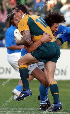 Australian Matt Rogers (r) is Tackle by Italian Alessandro Zanni During Their Rugby Union Match at the 'Flaminio' Stadium in Rome Italy on Saturday 11 November 2006 Italy in the Second Match of the Qantas Wallabies Annual Spring Tour During Which the Australian Side Will Take on Wales Italy Ireland and Scotland Italy Rome