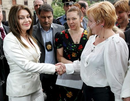 Veronica Lario (l) Wife of Italian Prime Minister Silvio Berlusconi and Lyudmila Putina (r) Wife of Russian President Vladimir Putin Shake Hands Monday 30 May 2005 in Front of Strheler Theatre in Milan Italy Italy Milano