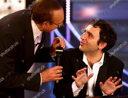 Presenters Pippo Baudo (l) Congratulates Italian Jazz Pianist Stefano Bollani After He Accompanied at the Piano As International Guest Compatriot Crooner Johnny Dorelli in the Song 'Meglio Cosi'' in Competition at the 57th Festival of Italian Song Better Known Sanremo Song Festival Late Thursday 02 March 2007 in 1998 Musica Jazz Magazine Voted Bollani Best Jazz Talent of the Year and Later He was Awarded For Jazz by a New Swing Group in Japan Recently He Attended the Jarasum Jazz Festival in Jarasum South Korea He Performs Classical Music Smooth Jazz Brazilian Jazz and Pop Rock Epa/claudio Onorati Italy San Remo