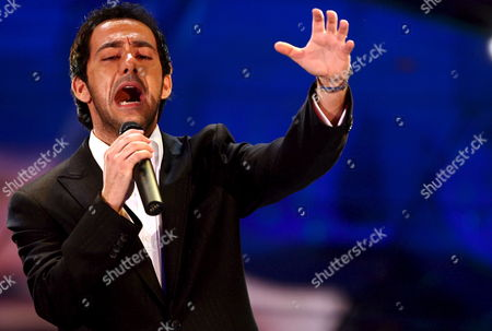 Stock Photo of Italian Tenor Piero Mazzocchetti -- Totally Unknown in Italy Until Now But Wellk Nown in Germany where He Sold 150 000 Records Austria and Switzerland Performs in the Song 'Schiavo D'amore' in Competition at the 57th Festival of Italian Song Better Known Sanremo Song Festival Late Thursday 02 March 2007 Mazzocchetti was Discovered -- in a Munich's Pub Haunted by Soccer Players of Bayern Munich -- by Karl Heinz Rumenigge E Franz Beckenbauer Epa/claudio Onorati Italy San Remo