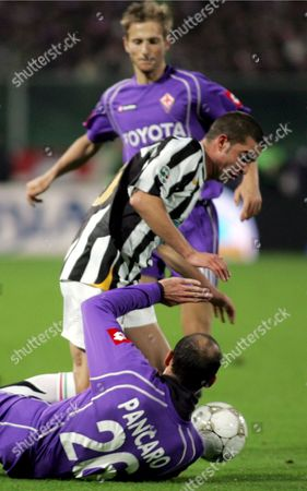Juventus' Romanian Player Adrian Mutu and Fiorentina's Giuseppe Pancaro in Action During Their Italian Cup Eighth of End Match in Florence 01 December 2005 Italy Florence