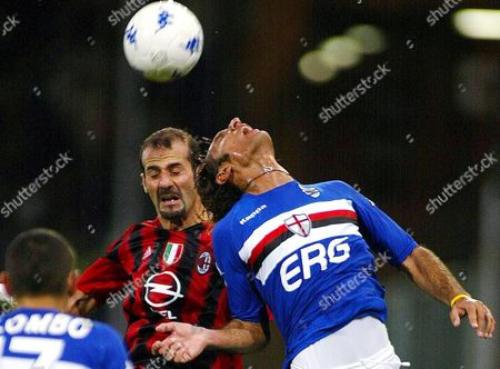 Fabio Bazzani (r) of Sampdoria Genoa and Giuseppe Pancaro of Ac Milan Struggle For the Ball with Their Heads During Their Italian Serie a Soocer Match in Genoa's Stadium on Saturday 30 October 2004 Italy Genoa