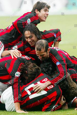 Players of Ac Milan (from Above to Below) Brazilian Ricardo Kaka' Alessandro Nesta Giuseppe Pancaro Captain Paolo Maldini and Andrea Pirlo Congratulate Their Portuguese Teammate Manuel Rui Costa (hidden) After He Scored Against Ancona During Their Italian Serie a Soccer Match in Milan's San Siro-giuseppe Meazza Stadium on Sunday 25 January 2004 Ac Milan Won 5-0 Italy Milan