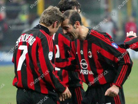 Defender Giuseppe Pancaro (r) of Ac Milan Jokes with Ukrainian Forward Andriy Shevchenko After He Scored the Third Goal For His Side His Second Personal Goal Against Sparta Prague During Their Champions League Soccer Match in Milan's San Siro-giuseppe Meazza Stadium Late Wednesday 10 March 2004 Ac Milan Won 4-1 Italy Milan