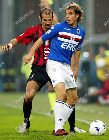 Cristian Zenoni (r) of Sampdoria Genoa Defends the Ball From Giuseppe Pancaro of Ac Milan During Their Italian Serie a Soocer Match in Genoa's Stadium on Saturday 30 October 2004 Italy Genoa,