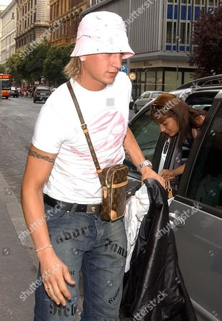 Auxerre's Soccer Player Philippe Mexes Upon His Arrival in a Rome Hotel Monday 12 July 2004 Auxerre Coach Guy Roux Claims Manchester United Offered an Acceptable ú10 Million (15 Million Euros) Sum For Philippe Mexes But Admits the Defender is Still Hankering For a Move to Roma Roux Revealed Last Week That the Red Devils Are Keen to Lure Mexes to Old Trafford But That the Player's Agent Rejected the Move Due to Concerns Over Regular Playing Time Italy Rome