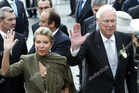 Vittorio Emanuele Di Savoia (r) Son of Italy' S Last King and His Wife Marina Doria Wave As They Arrive at Saint Mary of the Angels and Martyrs' Basilica in Rome For the Wedding Ceremony of Their Son Emanuele Filiberto and French Actress Clotilde Courau Thursday 25 September 2003 the Basilica Located in Square of the Republic is where the Great-grandfather of the Bridegroom King Vittorio Emanuele Iii Married Elena Di Montenegro in 1896 Emanuele Filiberto and His Parents Entered Italy For the First Time This Year After a 57-year-long Exile of the Former Italian Royal Family Epa Photo/ansa/filippo Monteforte// Italy Rome
