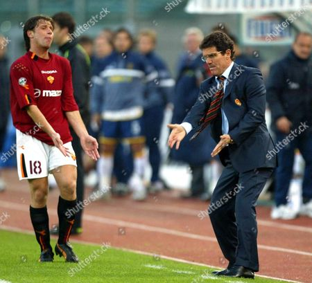 New Italian International Player and Forward of As Roma Antonio Cassano (l) Gestures As His Coach Fabio Capello Tries to Give Him Instructions During the Italian Serie a Soccer Match Against Lecce in Rome's Olympic Stadium on Sunday 30 November 2003 Mancini Had Earlier Scored the First Goal As Roma Won 3-1 Italy Rome