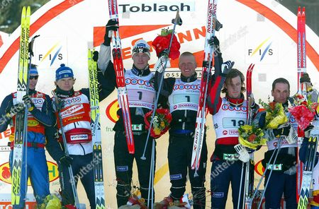 (l-r) Second Placed Swedish Peter Larsson and Thobias Fredriksson Norwegian Winners Haavard Bjerkeli and Tor Arne Hetland and Third Placed Norwegians Jon Kristian Dahl and Tore Ruud Hofstad Smile Opn the Podium After the Men's 10x1 5 Km Relay Cross Country World Cup Race in Dobbiaco Italy Sunday 07 December 2003 Italy Dobbiaco