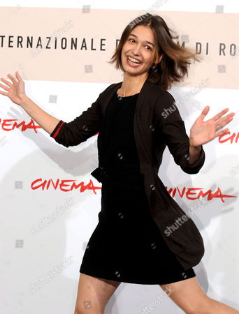 Stock Picture of Romanian Actress Ana Caterina Morariu Gestures During the Photo Call For the Film 'Il Sangue Dei Vinti' (blood of the Vanquished) by Italian Michele Soavi in Rome Italy on 26 October 2008 Presented in the Section 'Special Screenings' at the 3rd Rome International Film Festival Inspired by the Controversial Book by Giampaolo Pansa the Film Looks Back at the Story of a Family Torn Apart by Political Divisions at the Very End of the Second World War: the Son Joins the Partisan Brigades While the Daughter Starts to Serve in the Fascist Army Midway Between an Historical Reconstruction and a Political Thriller an Extreme Journey Through the Contradictions in Italy's Past Italy Rome