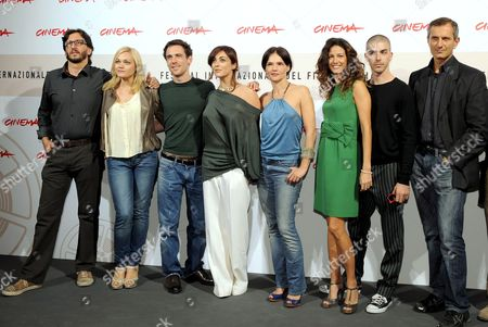 (l-r) Italian Movie Director Daniele Vicari Compatriot Actors Romina Carrisi Elio Germano Valentina Lodovini and Chiara Caselli Spanish Actress Maria Jurado Italian Actor Michele Riondino and Writer Gianrico Carofiglio Pose During the Photo Call For Their Film 'Il Passato E' Una Terra Straniera' (the Past is a Foreign Land) in Rome on 26 October 2008 Presented in Competition at the 3rd Rome International Film Festival the Film is About Two Youths - Giorgio Performed by Elio Germano and Francesco Performed by Michele Riondino - with Quite Different Characters who Become Friends and Undertake an Adventure Together Italy Rome