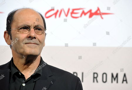 French Actor and Filmwriter Jean-pierre Bacri Poses During the Photo Call For the Film 'Parlez-moi De La Pluie' (let It Rain) by French Screenwriter Film Director Actress and Singer of Tunisian Jewish Descent Agnes Jaoui in Rome Late 26 October 2008 Presented out of Competition at the 3rd Rome International Film Festival the Film's Title is Inspired by the Song 'L'orage' by George Brassens Agathe Villanova is a Feminist and Recent Entrant to the Political Scene She Returns to Her Childhood Home to Help Her Sister Sort out Their Mother's Affairs Following Her Death a Year Earlier She is Closely Shadowed by Michel Ronsard a Failed Director and the Housekeeper's Son Karim who Are Making a Documentary About Successful Career Women Under a Permanently Gloomy Grey Summer Sky the Destinies of the Various Characters Are Played out Italy Rome