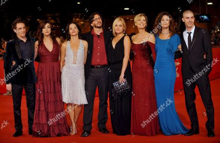Italian Movie Director Daniele Vicari (4 L) Poses with Actors (l-r) Elio Germano Valentina Lodovini Chiara Caselli Romina Carrisi Daniela Poggi Spanish Maria Jurado and Michele Riondino As They Arrive at Rome's Park of the Music Auditorium For the Screening of Their Film 'Il Passato E' Una Terra Straniera' (the Past is a Foreign Land) Late 26 October 2008 Presented in Competition at the 3rd Rome International Film Festival the Film is About Two Youths - Giorgio and Francesco Perforemed Respectively by Elio Germano and Michele Riondino - with Quite Different Characters who Become Friends and Undertake an Adventure Together Italy Rome