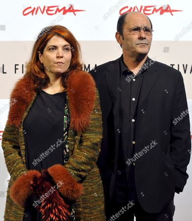 French Screenwriter Film Director Actress and Singer of Tunisian Jewish Descent Agnes Jaoui (l) and French Actor and Filmwriter Jean-pierre Bacri Pose During the Photo Call For Her Film 'Parlez-moi De La Pluie' (let It Rain) in Rome Late 26 October 2008 Presented out of Competition at the 3rd Rome International Film Festival the Film's Title is Inspired by the Song 'L'orage' by George Brassens Agathe Villanova is a Feminist and Recent Entrant to the Political Scene She Returns to Her Childhood Home to Help Her Sister Sort out Their Mother's Affairs Following Her Death a Year Earlier She is Closely Shadowed by Michel Ronsard a Failed Director and the Housekeeper's Son Karim who Are Making a Documentary About Successful Career Women Under a Permanently Gloomy Grey Summer Sky the Destinies of the Various Characters Are Played out Italy Rome