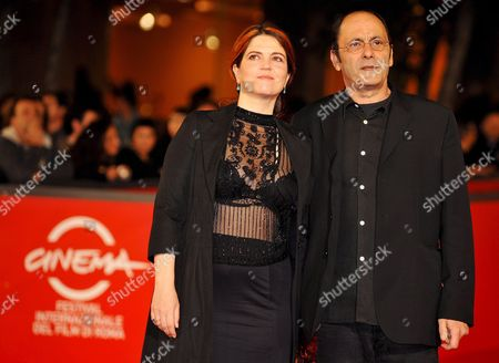 French Screenwriter Film Director Actress and Singer of Tunisian Jewish Descent Agnes Jaoui (l) and French Actor and Filmwriter Jean-pierre Bacri Pose As They Arrive at Rome's Park of the Music Auditorium For the Screening of Her Film 'Parlez-moi De La Pluie' (let It Rain) Late 26 October 2008 Presented out of Competition at the 3rd Rome International Film Festival the Film's Title is Inspired by the Song 'L'orage' by George Brassens Agathe Villanova is a Feminist and Recent Entrant to the Political Scene She Returns to Her Childhood Home to Help Her Sister Sort out Their Mother's Affairs Following Her Death a Year Earlier She is Closely Shadowed by Michel Ronsard a Failed Director and the Housekeeper's Son Karim who Are Making a Documentary About Successful Career Women Under a Permanently Gloomy Grey Summer Sky the Destinies of the Various Characters Are Played out Italy Rome