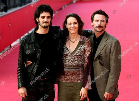 (l-r) French Director Olivier Masset-depasse with French Actress Anne Coesens and French Actor Sagamore Stevenin Pose For Photographers on the Red Carpet During the Rome International Film Festival in Rome on Wednesday 18 October 2006 Presenting the Film 'Cages' by Dirctor Masset-depasse Italy Rome