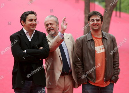Italian Producer Aurelio De Laurentis (c) Talks to French Film Directors Eric Toledano (l) and Olivier Nakache (r) on the Red Carpet Prior the Screening of the Film 'Nos Jours Hereux' at the Rome International Film Festival at Auditorium 'Parco Della Musica' in Rome Italy on Thursday 19 October 2006 Italy Rome