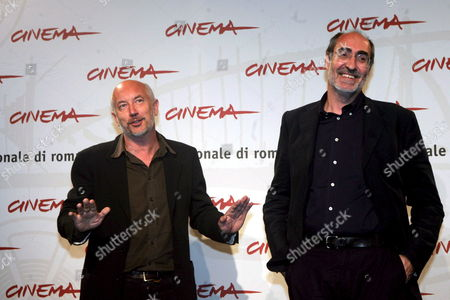 Italian Film Director Davide Ferrario (l) and Writer Marco Belpoliti Pose For Photographers During the Press Conference of His Film 'La Strada Di Levi' (primo Levi's Journey ) at the First Edition of Rome International Film Festival at the Auditorium 'Parco Della Musica' in Rome Italy on Thursday 19 October 2006 Italy Rome