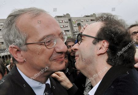 Candidate Premier of Democratic Party Valter Veltroni (l) and Oscar Academy Award-winning Italian Film and Television Actor and Director Roberto Benigni Grimace During an 'Electoral Walk' in Rome's Popular District Tiburtino Terzo in Which Benigni Accompanied Veltroni on 11 April 2008 During the Last Day of Electoral Campaign Before the 'Silence Day' in View of the Upcoming General Elections in Italy of 13 and 14 April Both Italian and Foreign Several Vips Officially Declared to Support Veltroni: Benigni Us Actor George Cooney Worldwide Wellknown Dance Etoile Carla Fracci Italian International Soccer Player and Captain of As Roma Francesco Totti Singer Songwriter Lorenzo 'Jovanotti' Cherubini Singer Fiorella Mannoia Movie Directors Francesca Archibugi and Paolo Virzi' Actors Laura Morante Alessandro Haber Isabella Ferrari Remo Girone Gigi Proietti Adriano Giannini and Sabrina Ferilli Tv Presenters Pippo Baudo and Serena Dandini Italy Rome