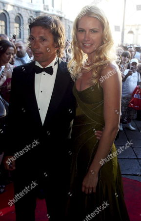 Argentinian Top Model Valeria Mazza (r) Arrives with Her Husband Alejandro Gravier at La Scala Theatre in Downtown Milan Late 15 July 2007 to Attend the Event Conceived by Maurice Bejart to Commemorate the 10th Anniversary of the Death of Italian Stylist Gianni Versace Gianni Versace was Gunned Down While Returning From His Customary Walk on Ocean Drive Outside His Ocean-front Mansion in Miami Beach Florida on 15 July 1997 Morning He was Murdered by Spree Killer Andrew Cunanan who Committed Suicide Shortly After the Murder Italy Milan