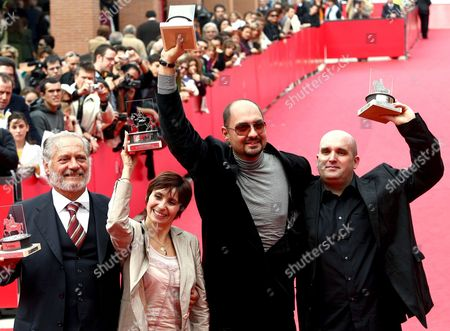 The Official Award Winners For the Films in Competition: (from Left) Best Italian Actor Giorgio Colangeli Best French Actress Ariane Ascaride Russian Director Kirill Serebrennikov and English Director Shane Meadows Pose with Their Awards Saturday 21 October 2006 During the First Edition of the International Film Festival in Rome Italy Roma