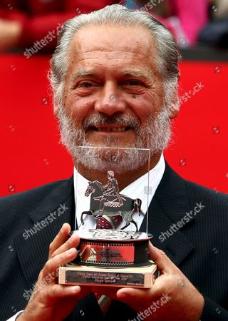 Italian Actor Giorgio Colangeli Poses with the Award He Won on Saturday 21 October 2006 For His Interpretation in the Film 'L'aria Salata' Directed by Alessandro Angelini in the First Edition of International Film Festival in Rome at Auditorium Parco Della Musica Italy Rome