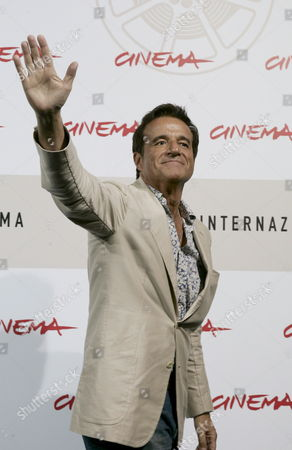 Italian Actor Christian De Sica (late Neorealist Movie Director and Actor Vittorio De Sica's Son) Waves During the Photocall of His Film 'Parlami Di Me' (speak Me About Me) Made by His Son Brando De Sica in Competition at the 3rd Rome Film Festival on 24 October 2008 a Resounding Solo by Christian De Sica in the Form of a Musical in a Stage Show That Brings Together Memories and Family Nostalgia Tracks by Garinei and Giovannini Personal and Autobiographical Monologues Also Touching on the History of the Variety Show Tributes to Great Cinema and Italian Showbiz the Spectacle is Written by Maurizio Costanzo and Enrico Vaime While the Film is Directed by Christian's Son Brando Making His Debut Behind the Camera Italy Roma
